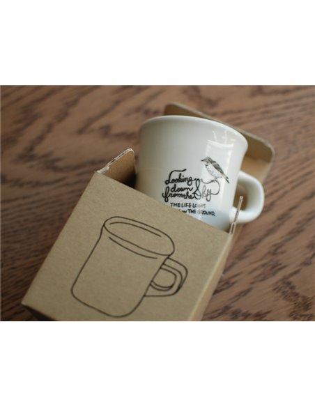 كوب قهوة من كنتو مع رسمة العصفور
